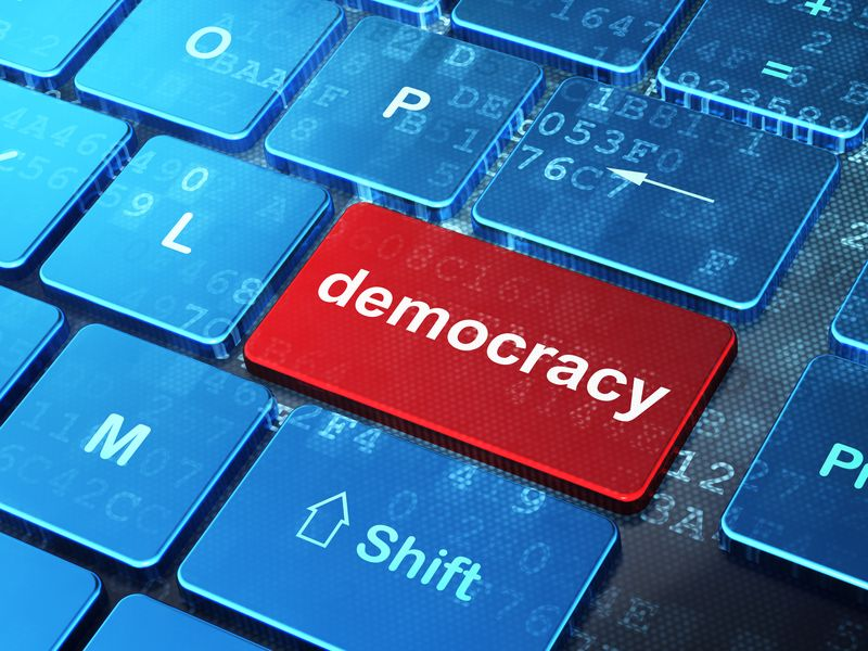 Political concept: Democracy on computer keyboard background